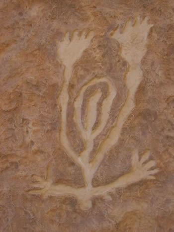 Ancient rock carving in Israel of a woman giving birth